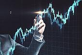 Businessman hand drawing gloving stock chart.