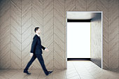 Businessman walking in contemporary gallery interior