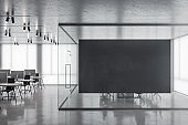 Office interior with empty black poster