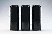 Front view of three black beverage drink cans