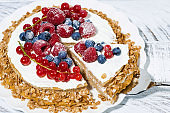 healthy sweet oatmeal cake with yoghurt and fresh berries, closeup