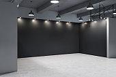 Minimalistic gallery interior with empty black wall