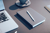 light wooden office table with notepad and pen