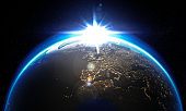 Earth with clouds, stars, and sun. Elements of this image furnished by NASA