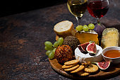 cheese, crackers and fruits, delicious wine snacks, top view
