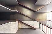 Modern staircase on concrete modern high-rise building interior.