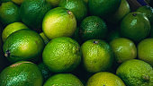 Texture full frame background from of ripe green limes