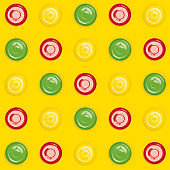 Colorful plates saucers pattern on yellow background