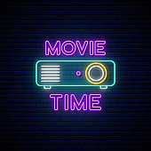 Cinema projection unit neon sign. Glowing neon projection machine on brick wall background with text Movie time. Vector illustration.