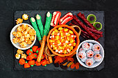 Halloween candy platter over a black stone background