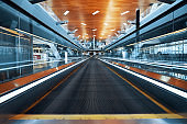 Empty moving walkway in modern shopping mall or airport