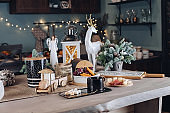 Festive Christmas decoration table with big cup of hot beverage with sugar and snack close-up