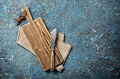 Rustic wooden cutting board and vintage cutlery