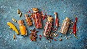 Mix bright spices in glass bottles as ingredient for healthy food