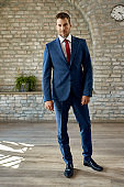 Full length of confident businessman in the office.