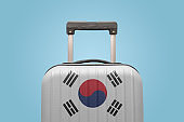 Baggage with South Korea flag print tourism and vacation concept.