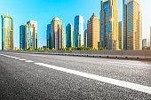 Shanghai urban architecture landscape and asphalt road in summer sunrise