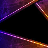 Purple and orange neon laser lines on grunge background