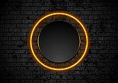 Orange neon circle on grunge brick wall background
