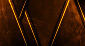 Dark orange neon laser lines on grunge luminous wall background