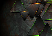 Black and glowing green orange triangles abstract background