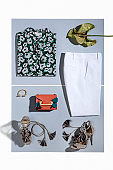 Fashionable women clothing with personal accessories isolated on gray background