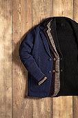 Fashionable jackets isolated on wood background