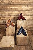 Fashionable leather shoes isolated on wood background