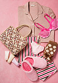 Fashionable women's clothing and personal accessories isolated on pink background