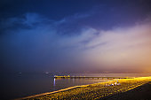 Beautiful night landscape. Bay on sea. Relax on beach. Night photography. Meet dawn on sea shore. Traveling in Europe. Relax on beach. Night sky