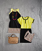 Fashionable women's clothing with personal accessories isolated on concrete wall(