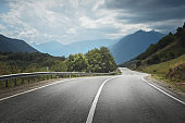 Country road to mountains. Travel
