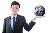 Businessman Holding a Planet Earth on His Palm of Hand