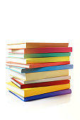 Stack of Colourful Books on White Background