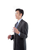 Handsome Asian Businessman Talking with Confident on White Background