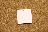 pink blank note paper on bulletin board