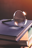 Close-up of Magnifying Glass on Books