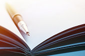 Close-up of a Pen Inside of an Opened Book