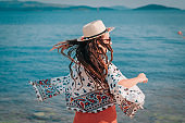 Excited Smiling Female Dancing on Summer Beach Sand