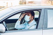Portrait of driver wearing protective medical mask