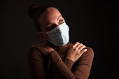 Young Woman Wearing Protective Mask In a Dark Room