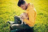 Guy and his dog, Golden Retriever, courtyard