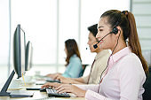Call center worker accompanied by her team.