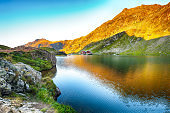 Majestic sunset view of Balea glacier lake near the Transfagarasan road.