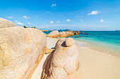 Gorgeous tropical beach turquoise transparent water unique rock boulders, Cam Ranh Nha Trang Vietnam south east coast travel destination, desert beach no people clear blue sky