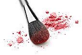 Make-up brush and crushed pink eye shadow