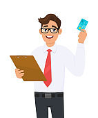 Young business man in eye glasses holding clipboard and showing credit, debit or ATM card. Person carrying document or file. Male character keeping folder, checklist. Cartoon illustration in vector.
