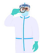 Person in safety protection suit uniform, mask, goggles and face shield looking through magnifying glass. Doctor holding magnifier lens. Physician or surgeon wearing personal protective equipment.