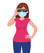 Young woman in medical face mask, looking the distance through binoculars. Girl holding digital telescope. Female character. Corona virus epidemic outbreak. Modern technology. Cartoon illustration.