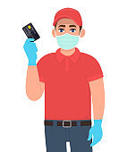 Delivery person or courier in mask and gloves showing credit card. Man holding debit, ATM card. Male character. Corona virus epidemic outbreak. Online shopping service. Digital payment technology.